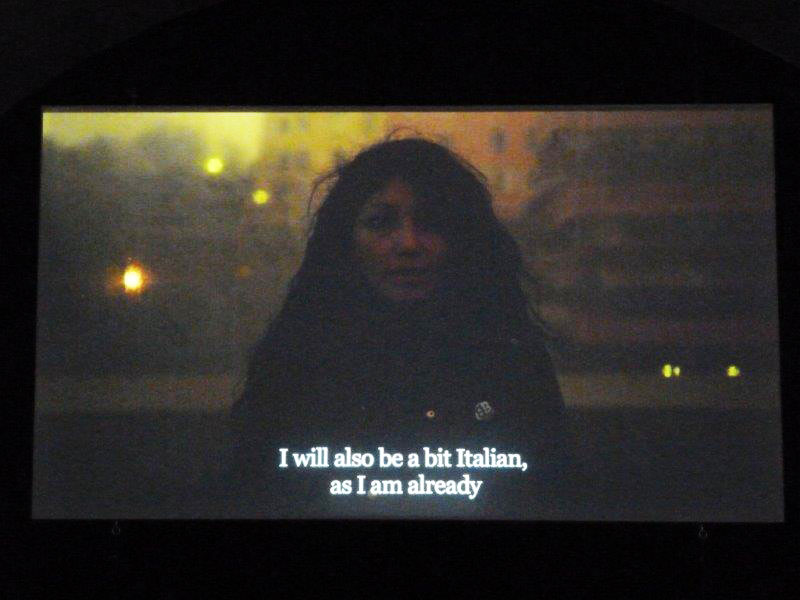 Video still of woman with subtitles: I will also be a bit Italian, as I am already