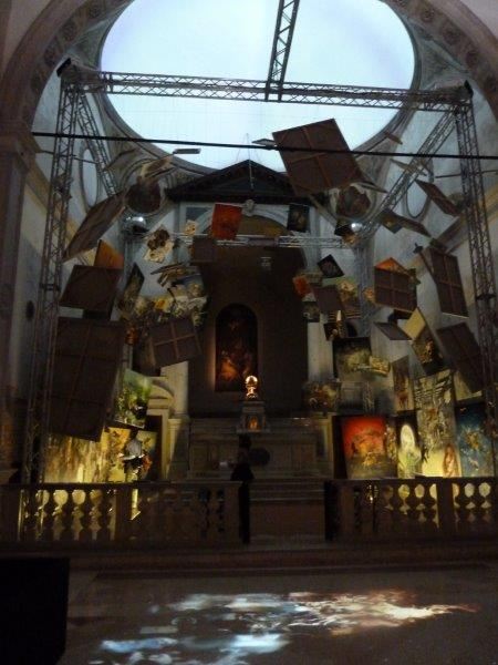Church space filled with hanging paintings as art instalation